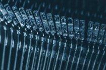 Close-up metal typebar of mechanical typewriter — Stock Photo