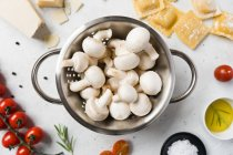 White mushrooms and ingredients for ravioli preparing on table — Stock Photo