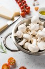White mushrooms and ingredients for cooking on table — Stock Photo