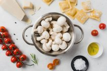 White mushrooms and ingredients for ravioli preparing on table — Stock Photo