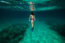 Anonymous boy snorkeling in sea water — Stock Photo