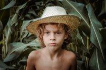 Boy in hat in cornfield — Stock Photo