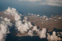 Aerial view of land near blue water, Mykonos, Greece — Stock Photo