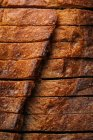 Closeup of sliced homemade rustic bread loaf — Stock Photo