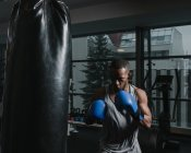 African American boxer training in gym — Stock Photo