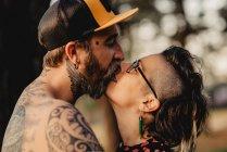 Happy couple kissing on sunny weather — Stock Photo