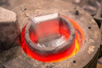 Metal ware melting in crucible — Stock Photo