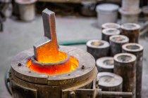 Metal ware melting in crucible — Stock Photo