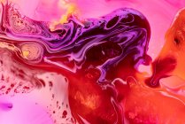 Abstracción de pinturas líquidas en mezcla de flujo de mezcla lenta - foto de stock