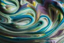 Abstrakte bunte Rasiercreme auf weißer Leinwand — Stockfoto