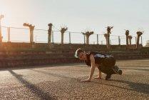 Teenager break dancing on sports ground — Stock Photo