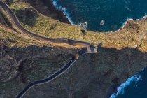 Curving road through desert landscape and sea coast — Stock Photo