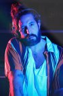 Portrait of bearded Dj man playing disco music in a club — Stock Photo