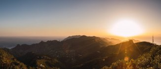 Panoramic view of bright sunset in mountains — Stock Photo