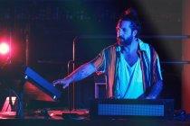 Bearded Dj man playing disco music in a club — Stock Photo