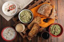 Tasty sauces decorated with sesame seeds and lush bread — Stock Photo