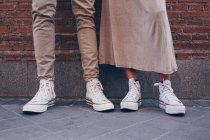 Low section of couple standing in street next to each other — Stock Photo