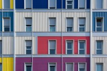 Exterior of contemporary colorful urban house with long half opened narrow windows — Stock Photo