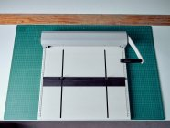 Handheld binding machine for preparing books cover in printing house — Stock Photo