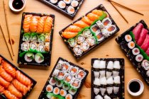 Top view of delicious sushi served on table in restaurant. — Stock Photo