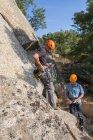 View of climbers preparing their equipment to start climbing — Stock Photo