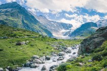 Amazing landscape of river flowing among stones between mountains in Switzerland — Stock Photo