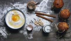 Ingredients for Christmas cake recipe on table powdered with flour, top view — Stock Photo