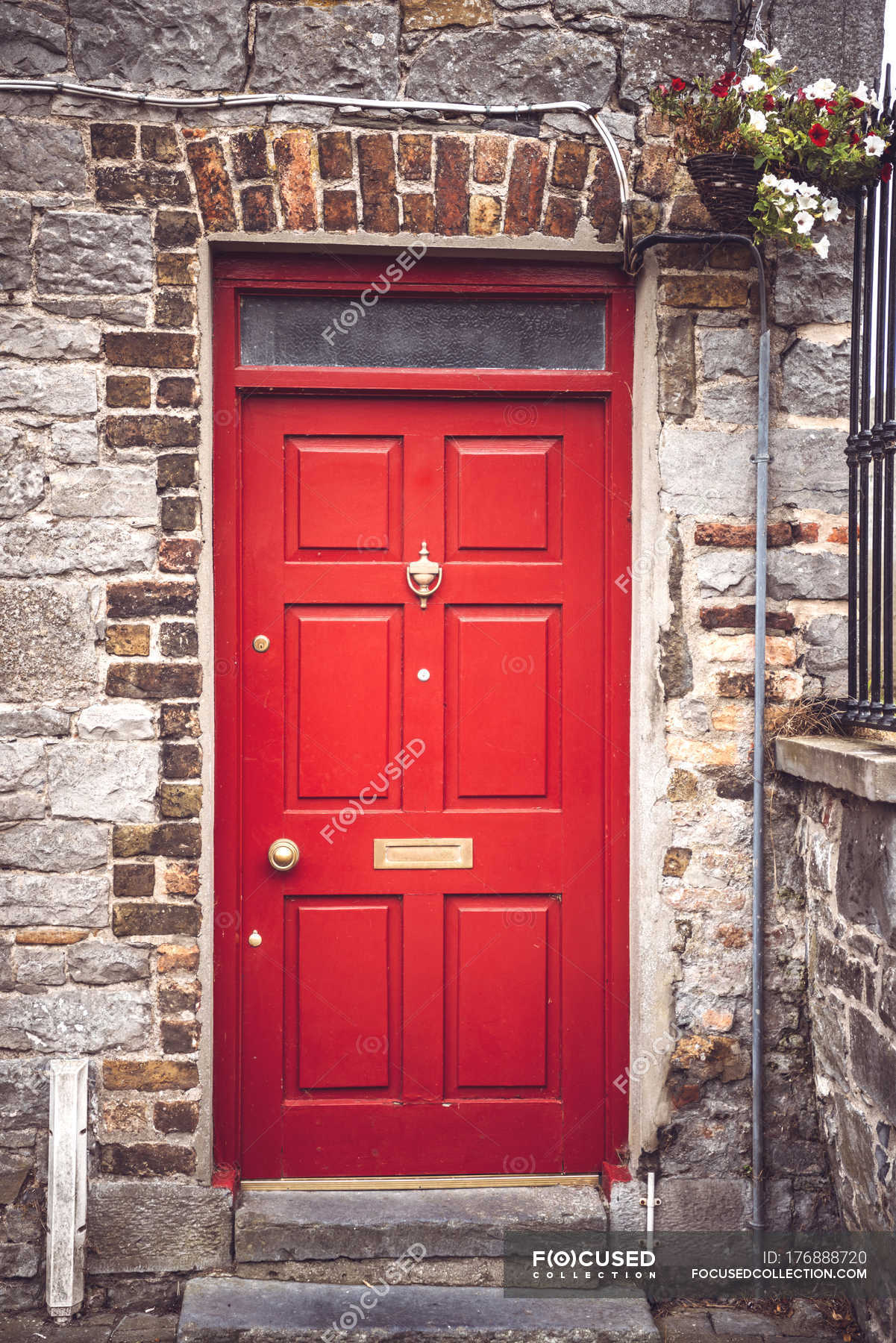 Bright Red Door In Brick Wall Of Common Rural House Stock Photos