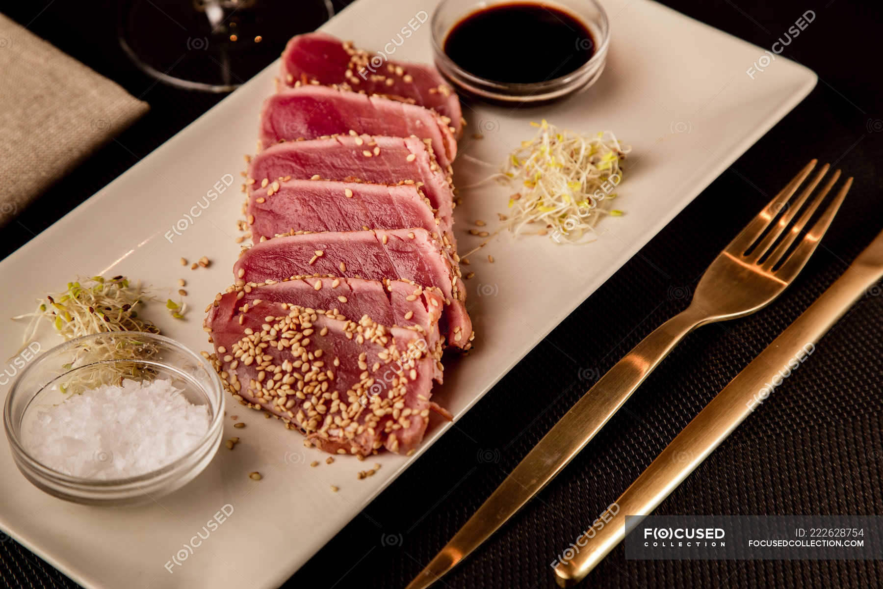 Raw Sliced Tuna Steak On Platter With Sauce On Black Background Seafood Cooked Stock Photo 222628754