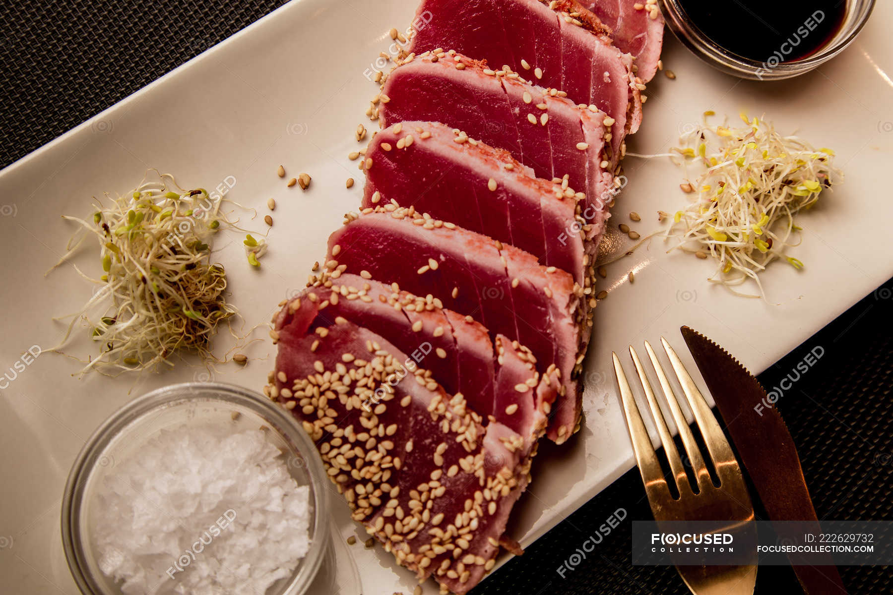 Raw Sliced Tuna Steak On Platter With Sauce On Black Background Dish Close Up Stock Photo 222629732