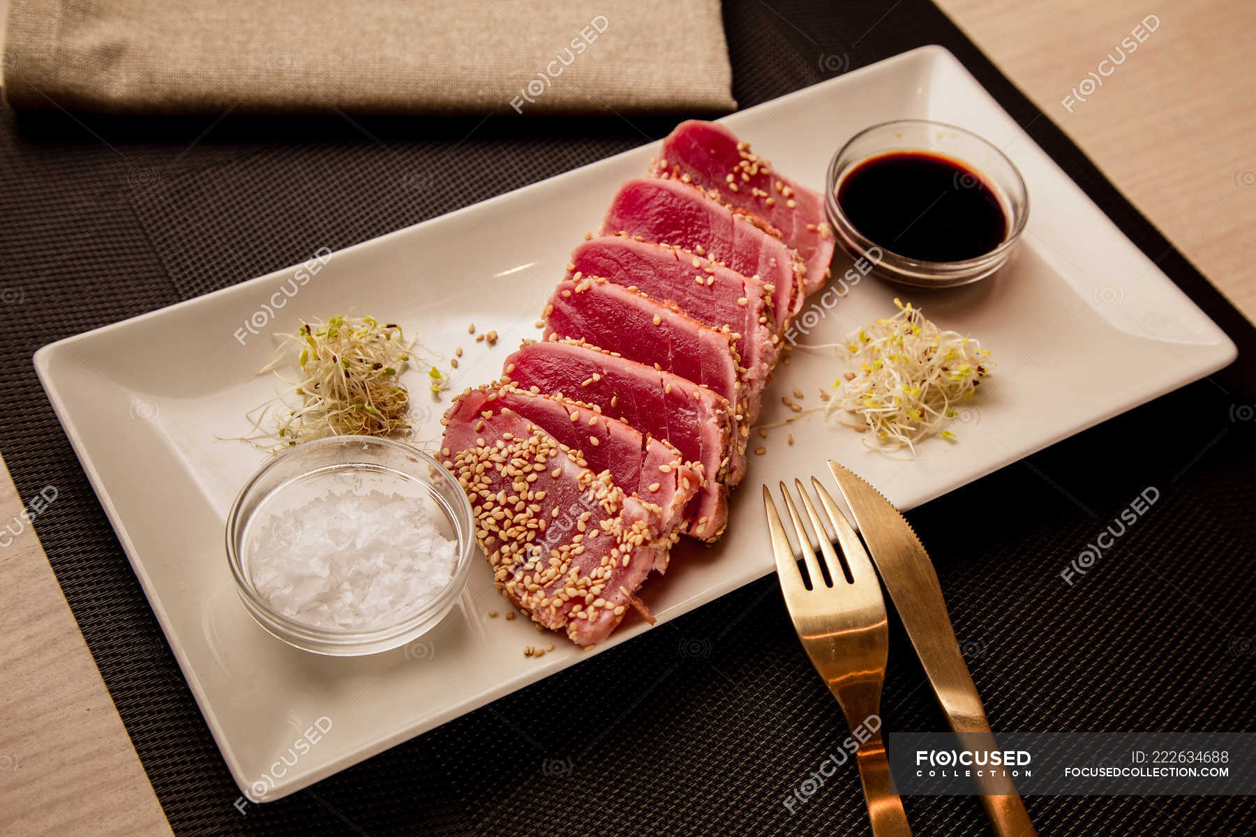 Raw Sliced Tuna Steak On Platter With Sauce On Black Background Portion Ingredients Stock Photo 222634688