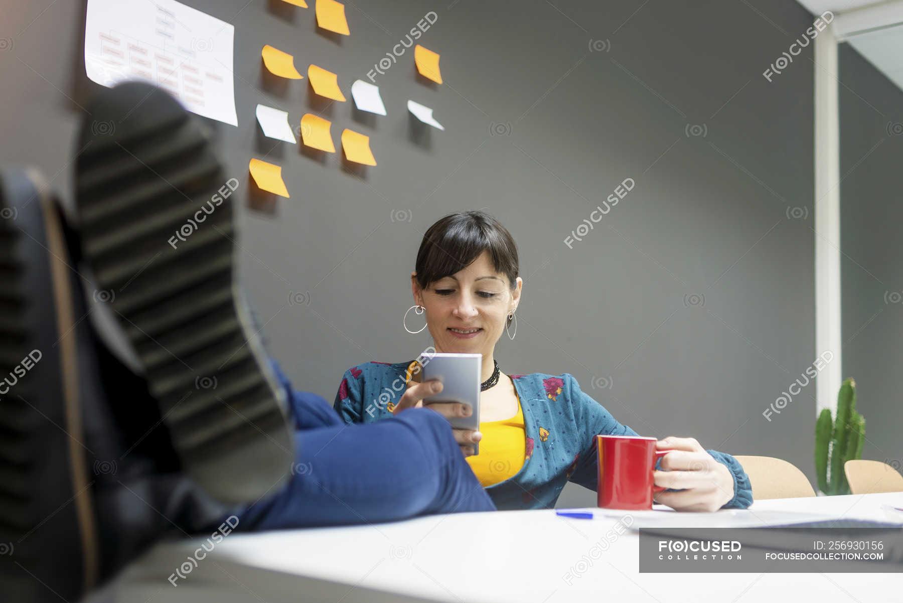 Female Manager With Mug Of Hot Beverage