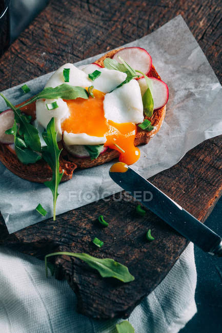 Toast with poached egg — Stock Photo