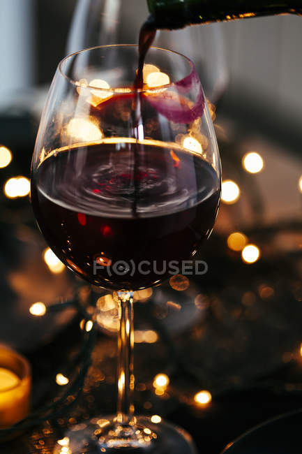 Glass of red wine with lipstick imprint — Stock Photo