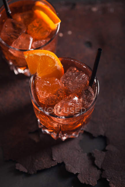 Glasses of vermouth with ice and orange — Stock Photo