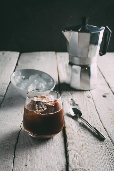 Coffee with ice on table — Stock Photo