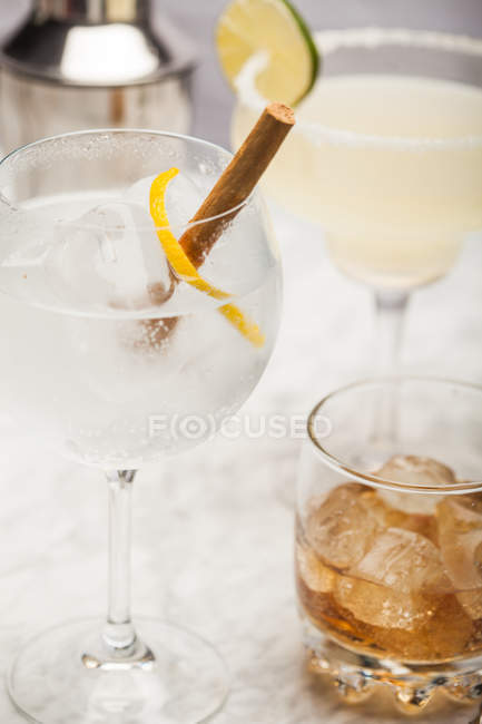 Glasses with different drinks on table — Stock Photo