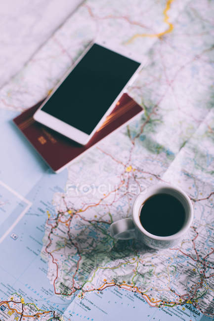 Smartphone, passport, cup of coffee — Stock Photo