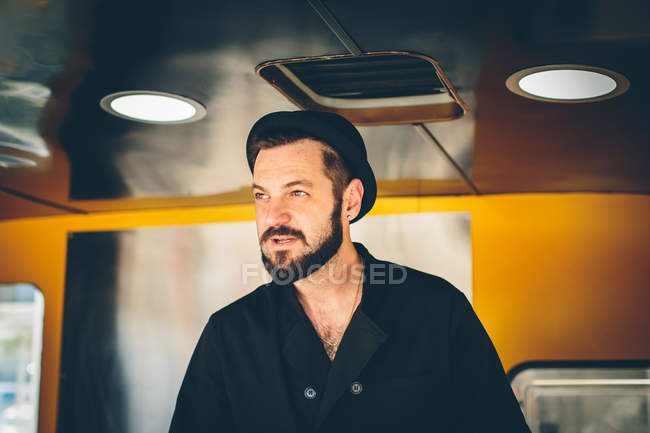 Stylish man cook in food truck — Stock Photo