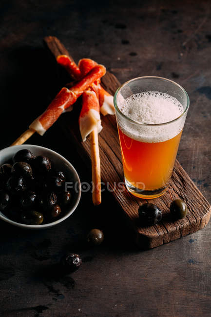 Glass of light beer on wooden plank. — Stock Photo