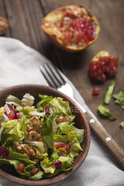 Salad with walnuts and pomegranate seeds — Stock Photo