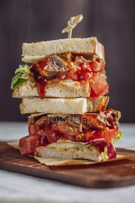Sandwich with meat, salad and tomatoes — Stock Photo