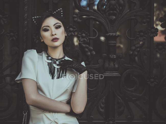 Elegant asian woman in cat ears — Stock Photo