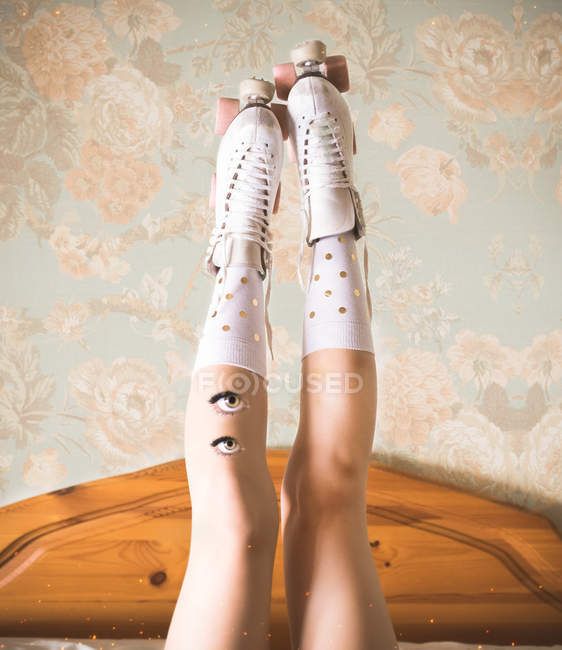 Woman legs in roller skates with pair of eyes — Stock Photo