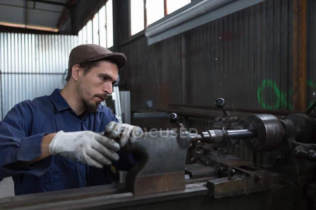 Man working with iron machine — Stock Photo