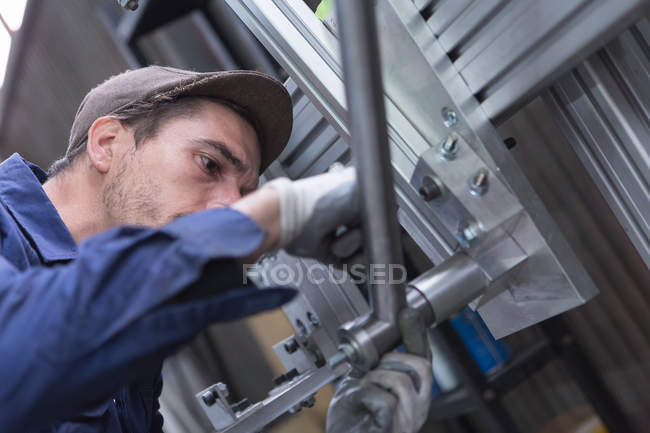 Man working with iron details — Stock Photo