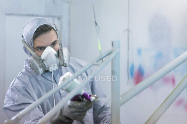 Painter in process of painting frame — Stock Photo