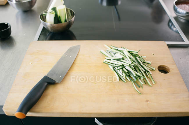 Sliced raw vegetable with knife — Stock Photo
