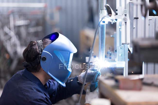 Craftsman working with welding machine — Stock Photo