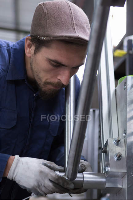 Worker constructing bike details — Stock Photo